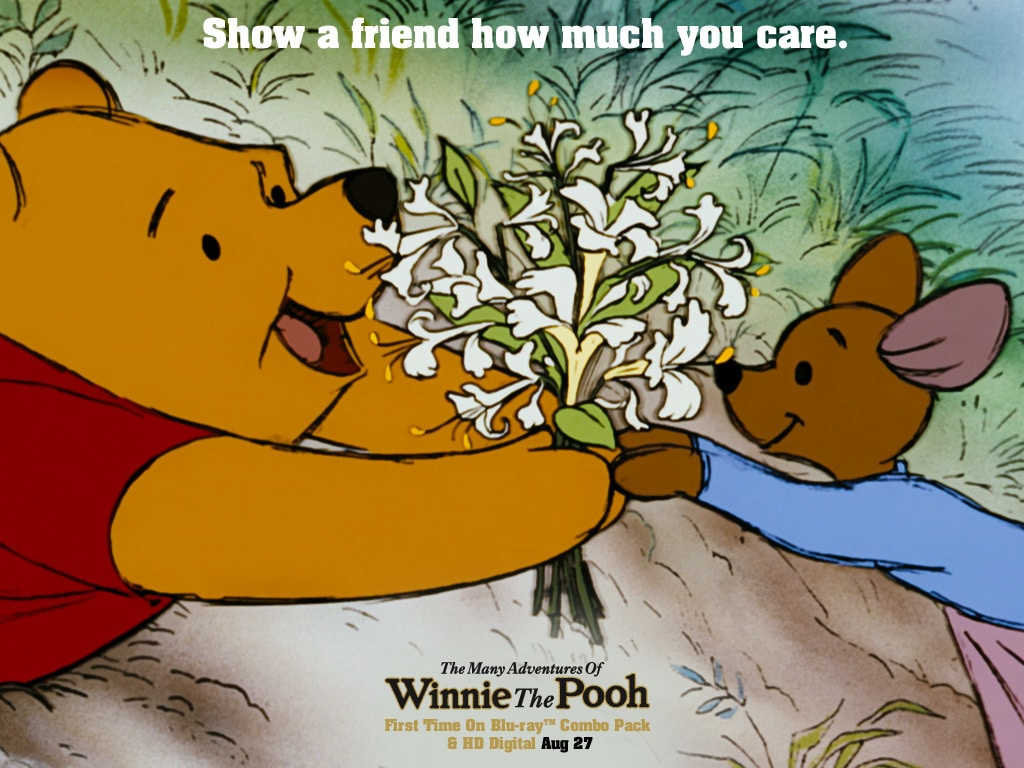 Roo (voiced by Clint Howard) giving flowers to Pooh (voiced by Sterling Holloway) in the movie The Many Adventures Of Winnie The Pooh
