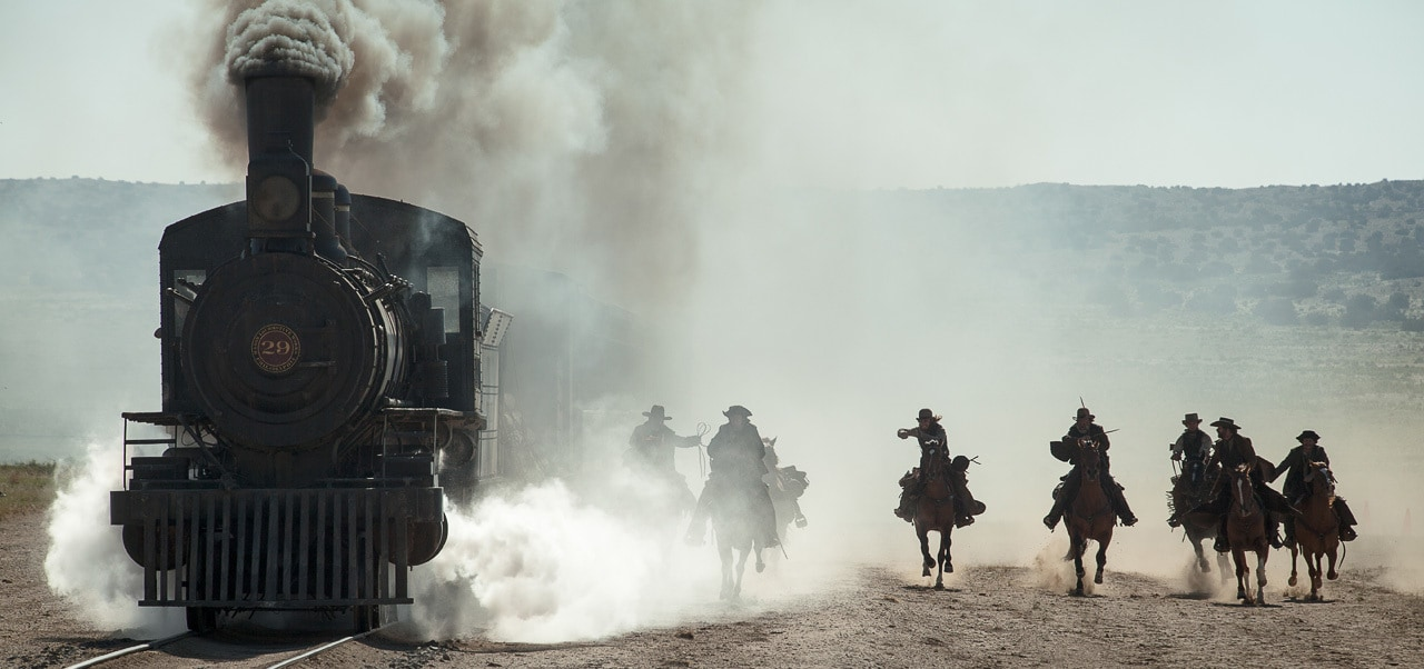 """A group of outlaws approaching a moving train from the movie """"The Lone Ranger"""""""