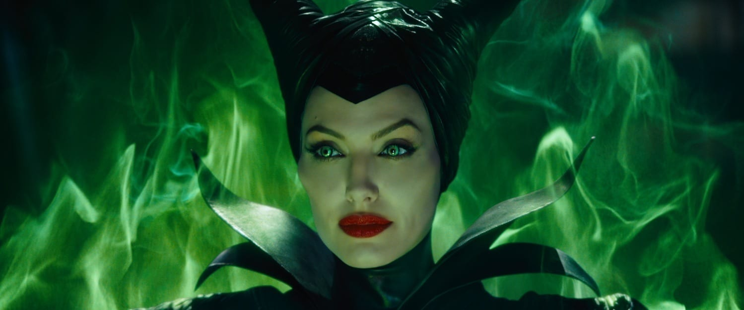 """Angelina Jolie as Maleficent, surrounded by green smoke, in the movie """"Maleficent"""""""