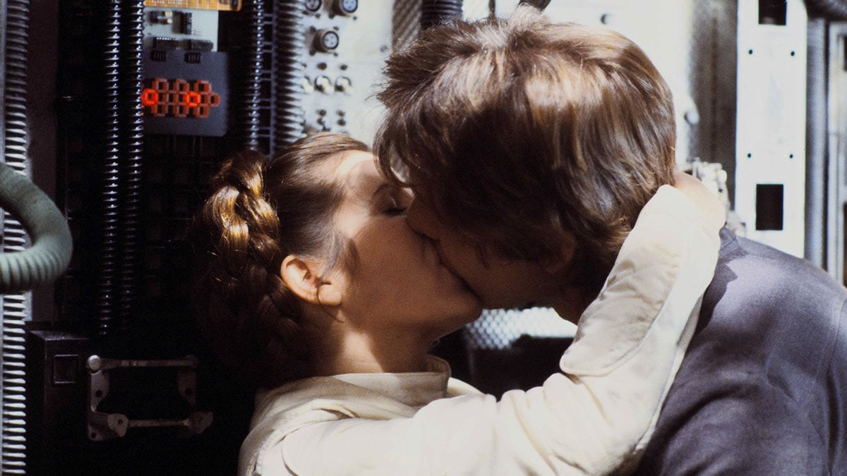 Princess Leia kissing Han Solo on the Millennium Falcon