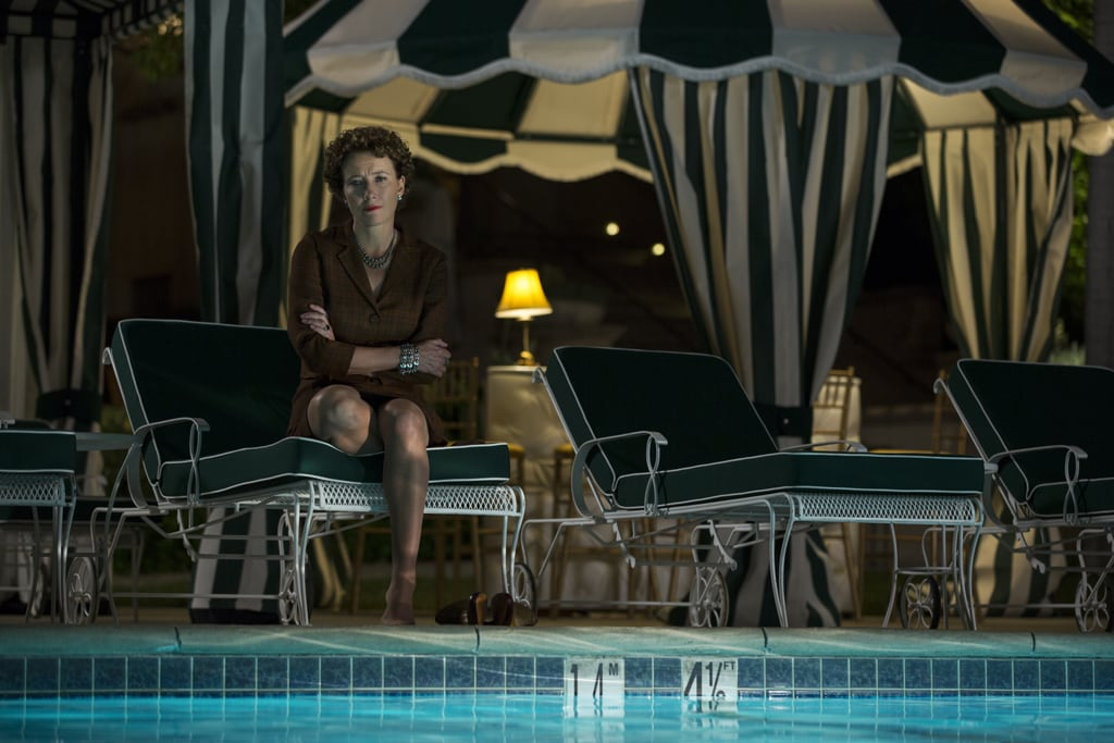 """Actor Emma Thompson as P.L. Travers sitting on a lounge chair by a pool at night in the movie """"Saving Mr. Banks""""."""