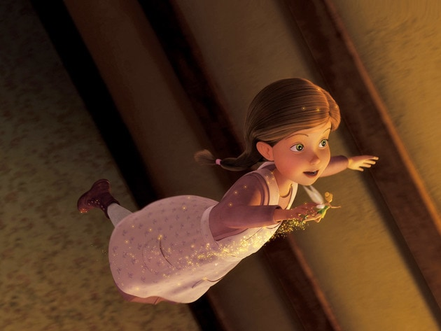 With a little pixie dust, Lizzy flies around her room.
