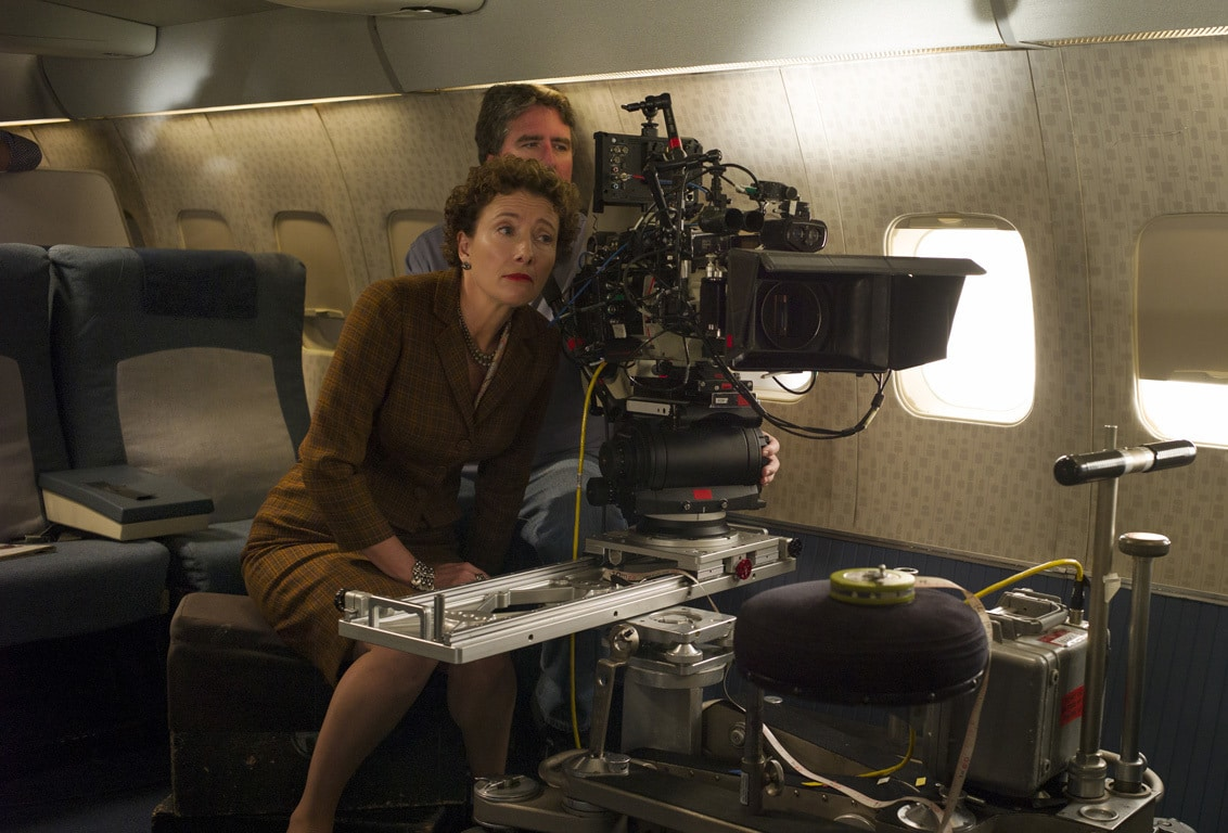 """Actor Emma Thompson (as P.L. Travers) looking through a camera behind-the-scenes in the movie """"Saving Mr. Banks""""."""