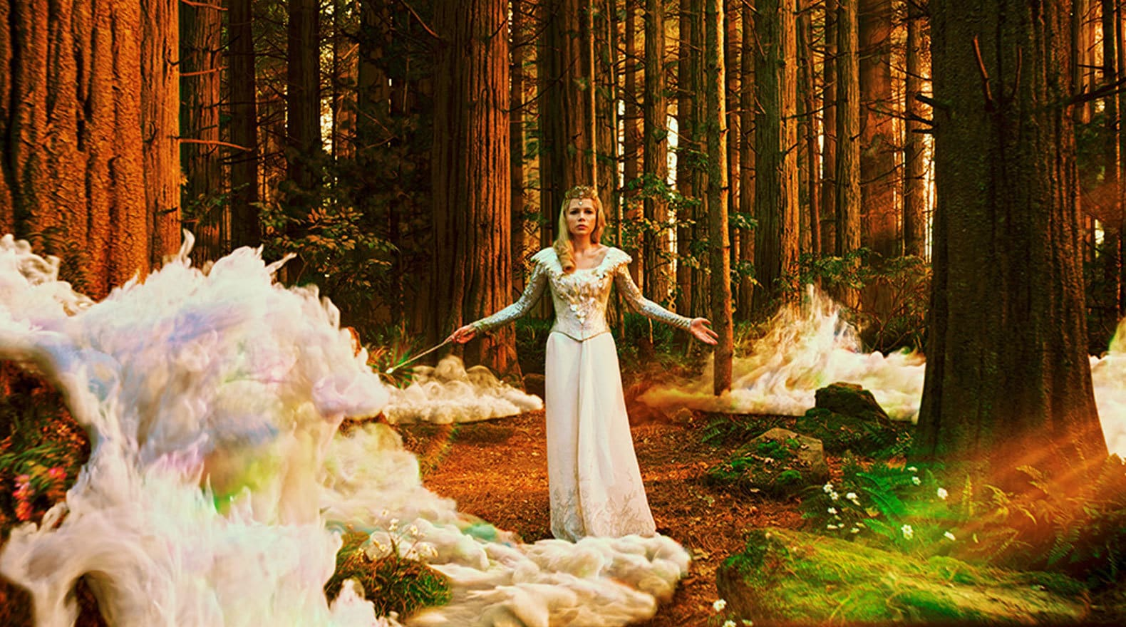 """Glinda the Good standing in the woods from the movie """"Oz the Great and Powerful"""""""