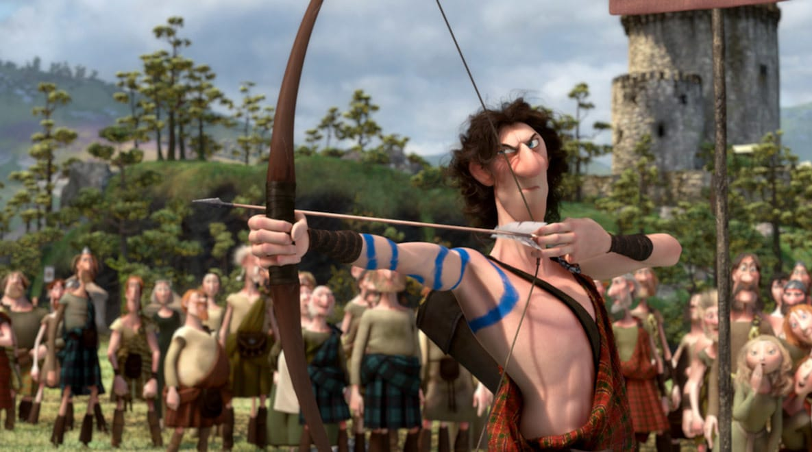Young Macintosh (played by Steven Cree) aiming a bow and arrow in the movie Brave