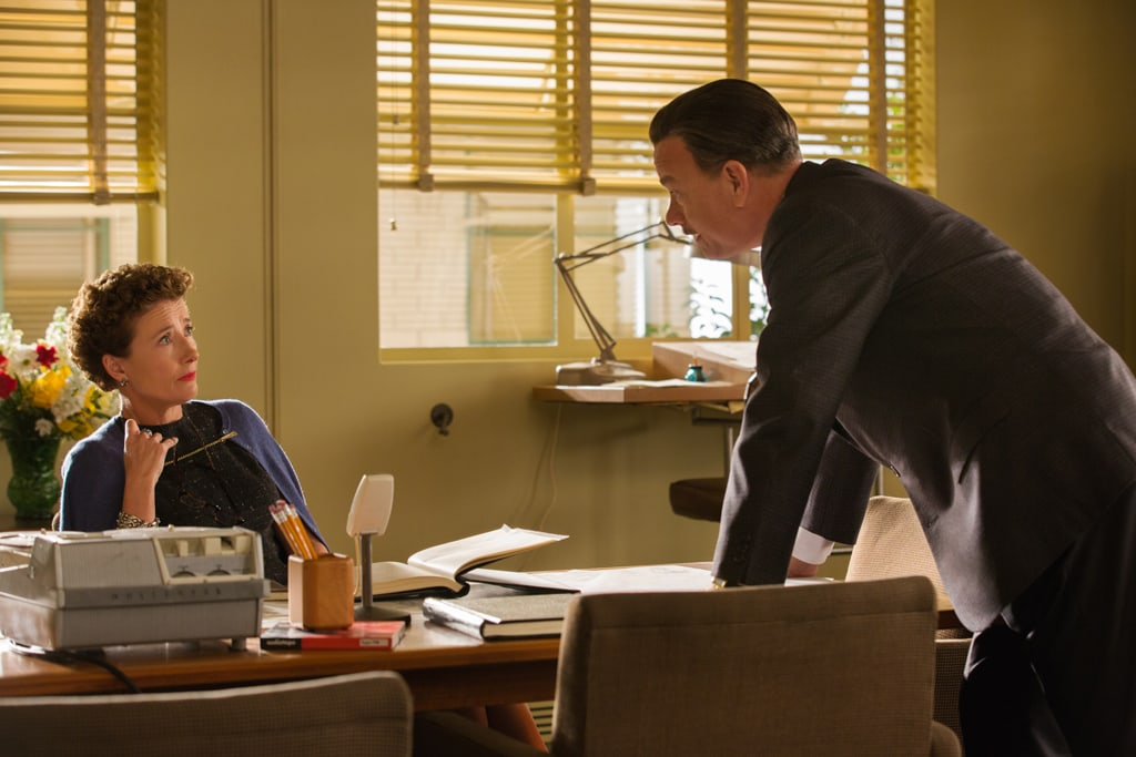 """Actors Tom Hanks (as Walt Disney) and Emma Thompson (as P.L. Travers) at a desk in the movie """"Saving Mr. Banks""""."""