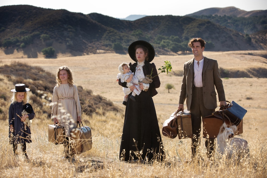 """Actors Colin Farrell (as Travers Goff), Ruth Wilson (as Margaret Goff), Annie Rose Buckley (as Ginty), and Lily Bigham (as Biddy) standing in a prairie in the movie """"Saving Mr. Banks""""."""