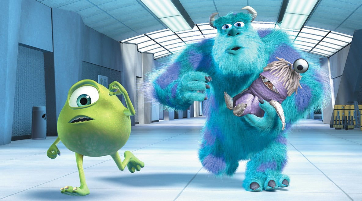 Billy Crystal as Mike Wazowski, John Goodman as Sully holding a costumed Boo running through the halls in Monsters, Inc.