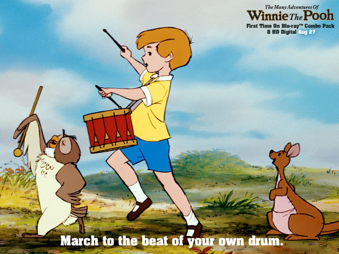 Owl (voiced by Hal Smith), Christopher Robin (voiced by Buce Reitherman), and Kanga (voiced by Barbara Leddy) marching with drums in the movie The Many Adventures Of Winnie The Pooh