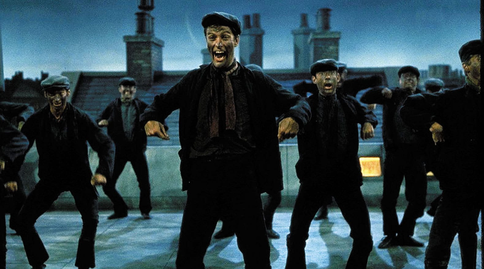 """Bert and a group of chimney sweepers dancing in """"Mary Poppins"""""""