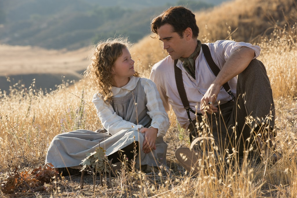 """Actors Colin Farrell (as Travers Goff) and Annie Rose Buckley (as Ginty) in the movie """"Saving Mr. Banks""""."""