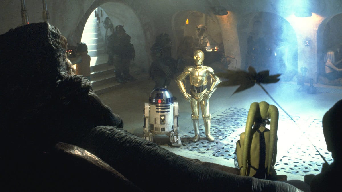 R2-D2 and C-3PO addressing Jabba the Hutt in his Palace