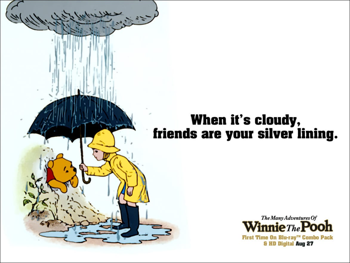 Christopher Robin (voiced by John Walmsley) holding and umbrella over Pooh (voiced by Sterling Holloway) in the movie The Many Adventures Of Winnie The Pooh
