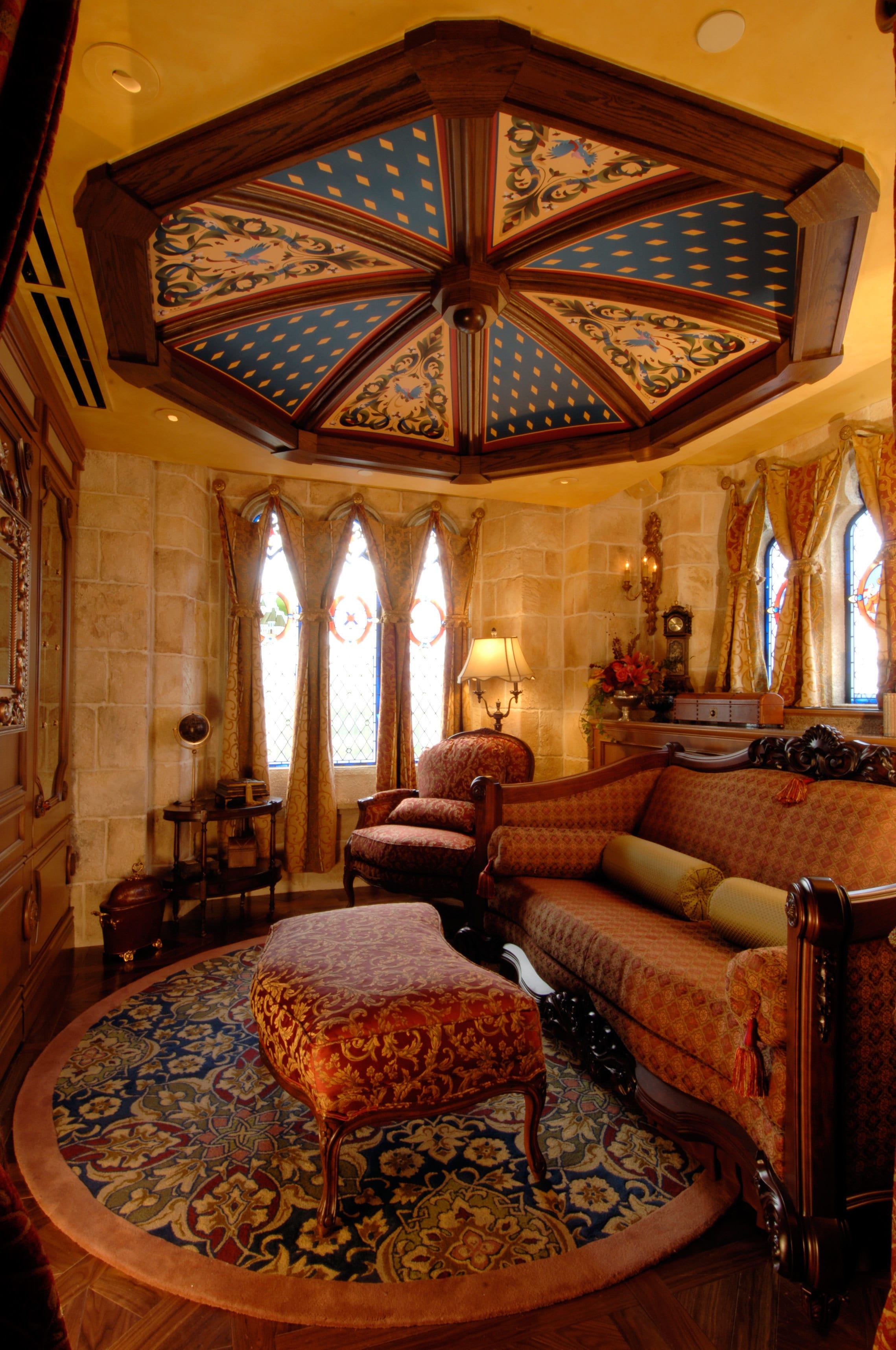 The sitting room inside the Cinderella Castle Suite is anchored by a custom sofa bed – a one-of-a...