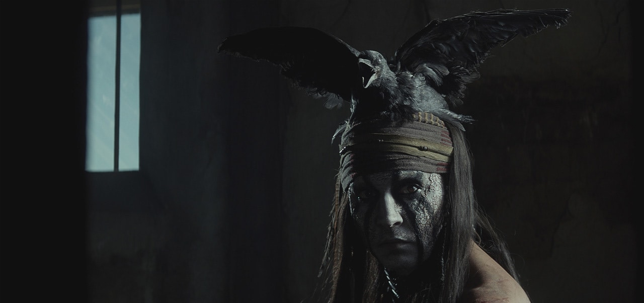 """Image of Tonto with a crow on his head from the movie """"The Lone Ranger"""""""