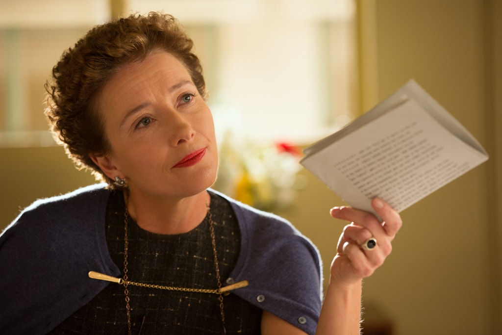 """Actor Emma Thompson as P.L. Travers holding a folded piece of paper in the movie """"Saving Mr. Banks""""."""