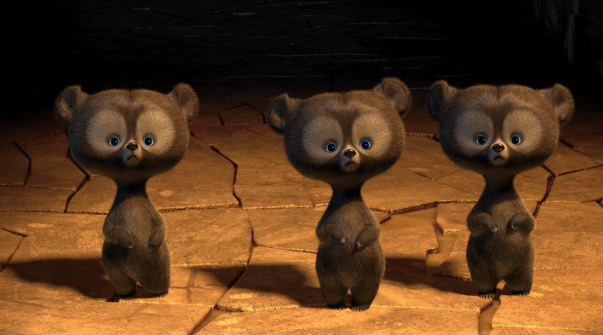 Three little bears (the triplets) looking surprised in the movie Brave
