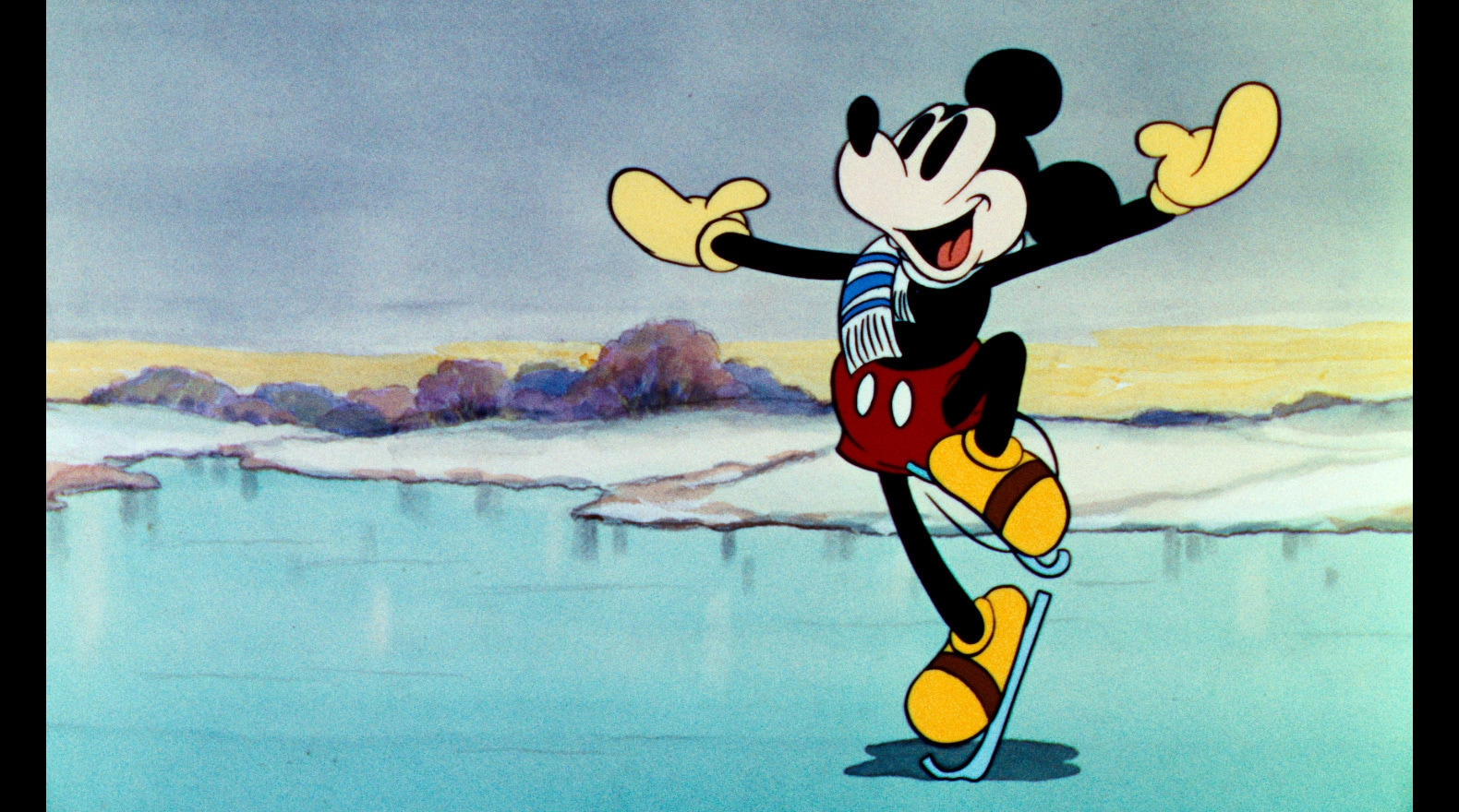 Mickey tries to impress Minnie with his skating skills.