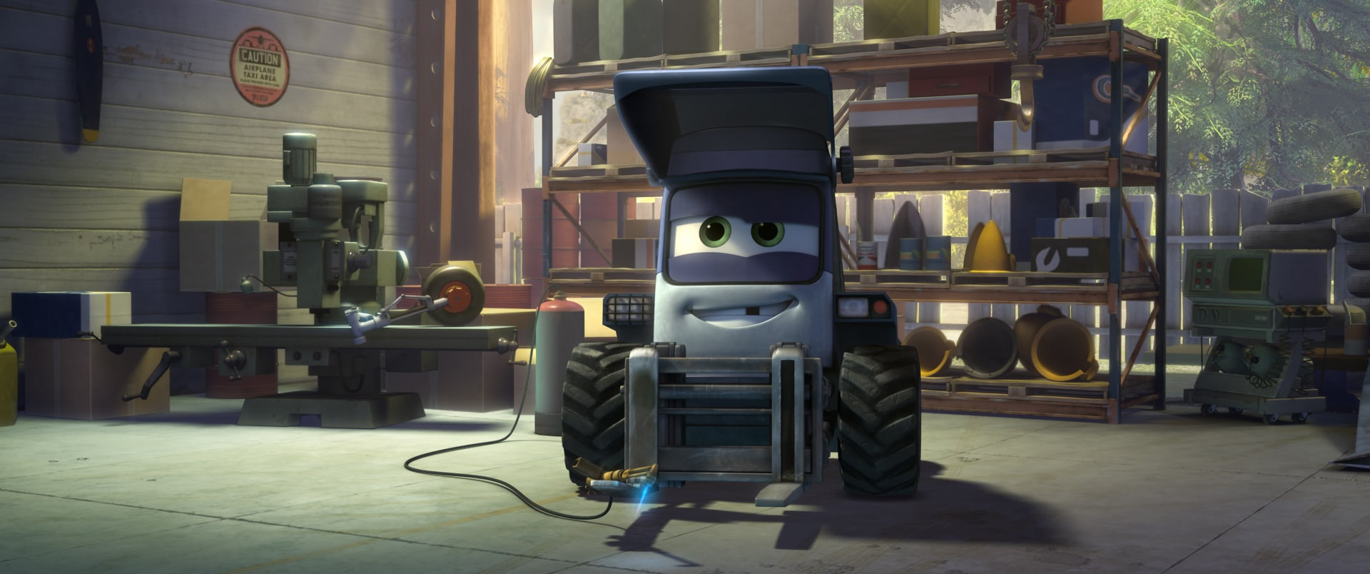 """Maru (Curtis Armstrong) the mechanic tug at Piston Peak Air Attack base. From the movie """"Planes: Fire & Rescue"""""""
