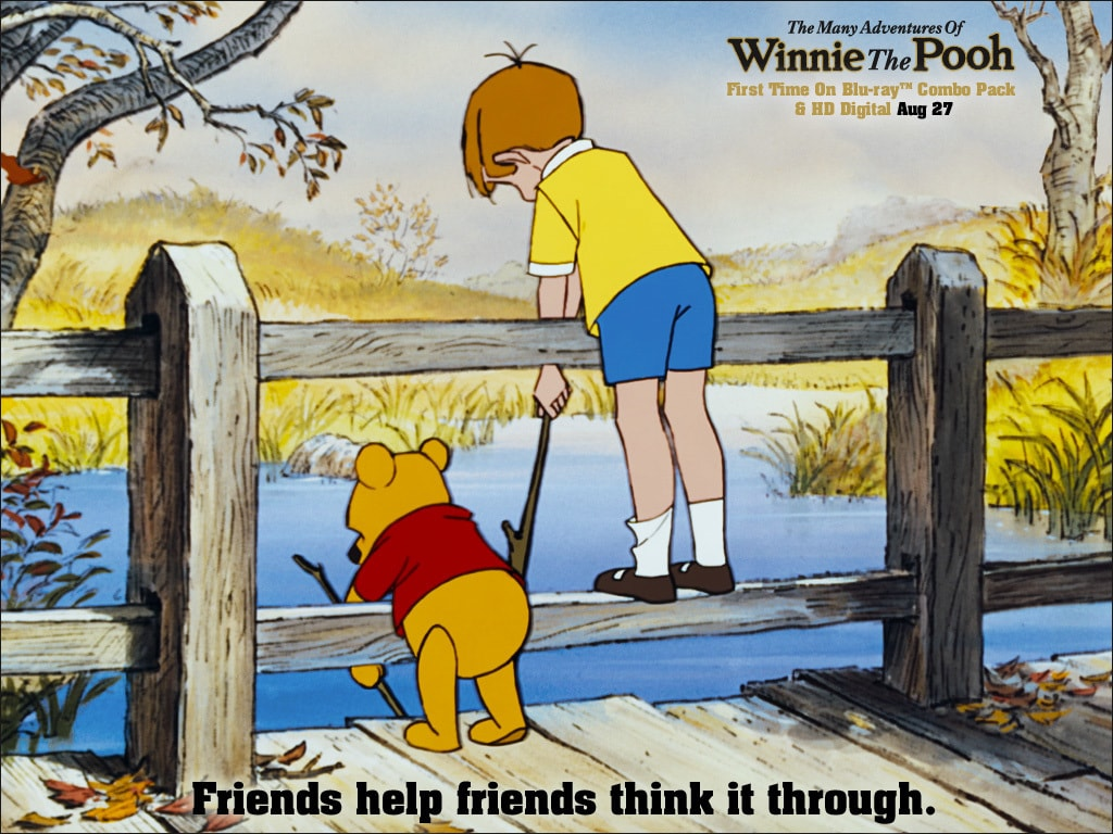 Pooh (voiced by Sterling Holloway) and Christopher Robin (voiced by John Walmsley) looking over a bridge into a river in the movie The Many Adventures Of Winnie The Pooh