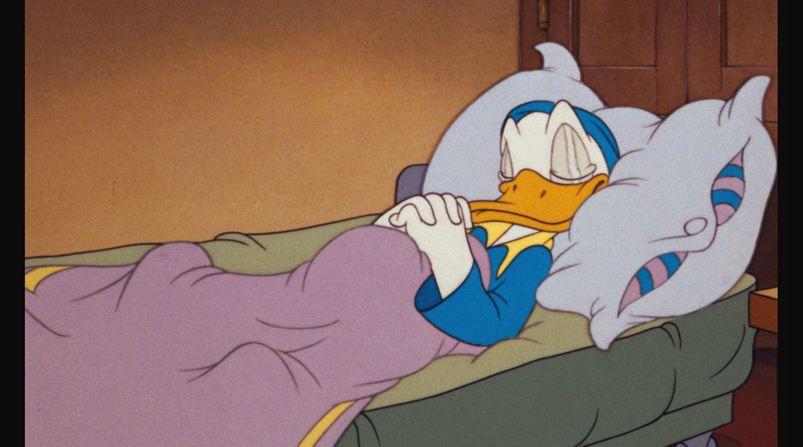 When Donald tries to get to bed early, life intervenes in the form of alarm clocks and bed springs.