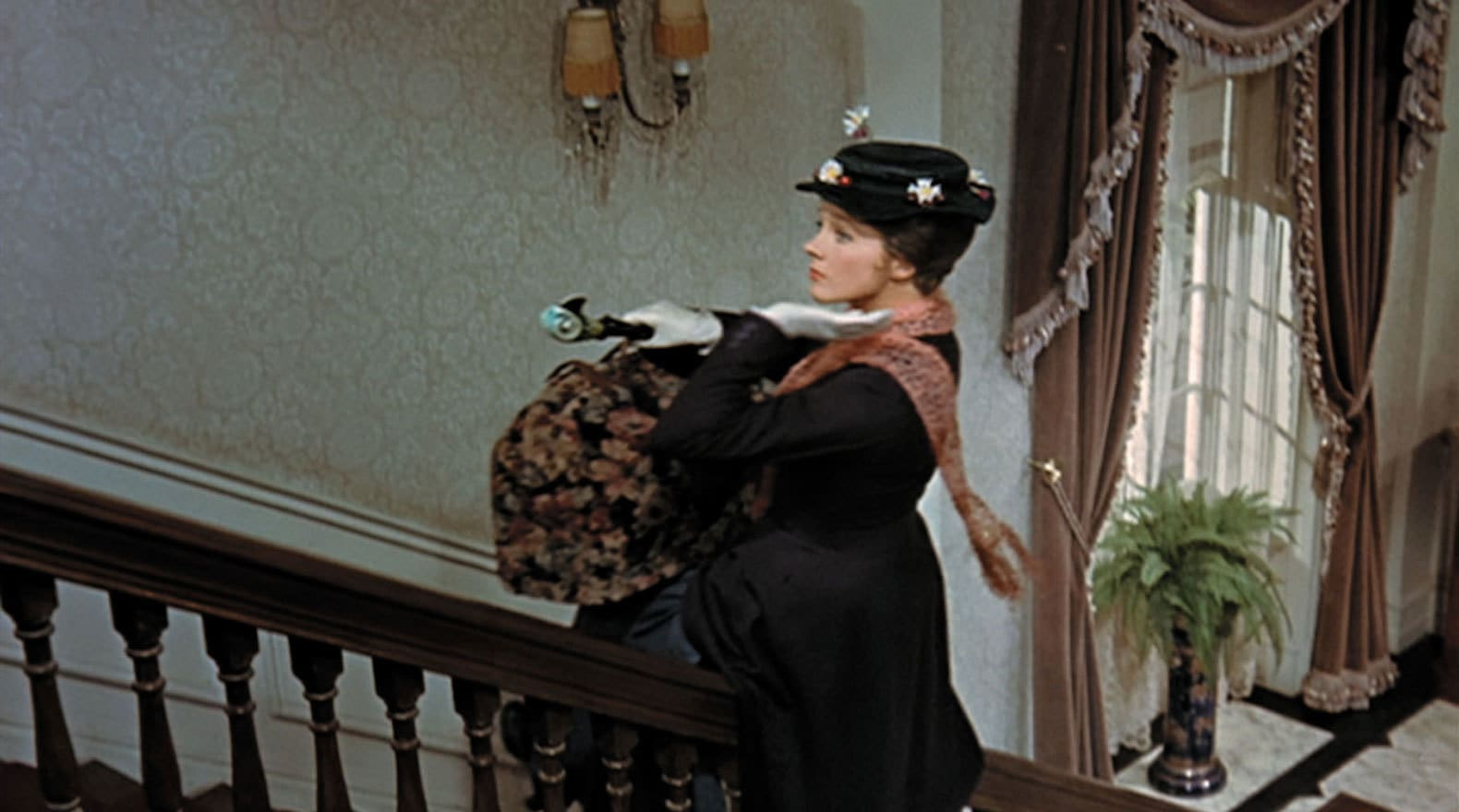 """Mary Poppins gliding up the banister in """"Mary Poppins"""""""