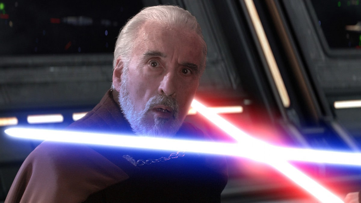 Count Dooku kneeling at the mercy of Anakin Skywalker