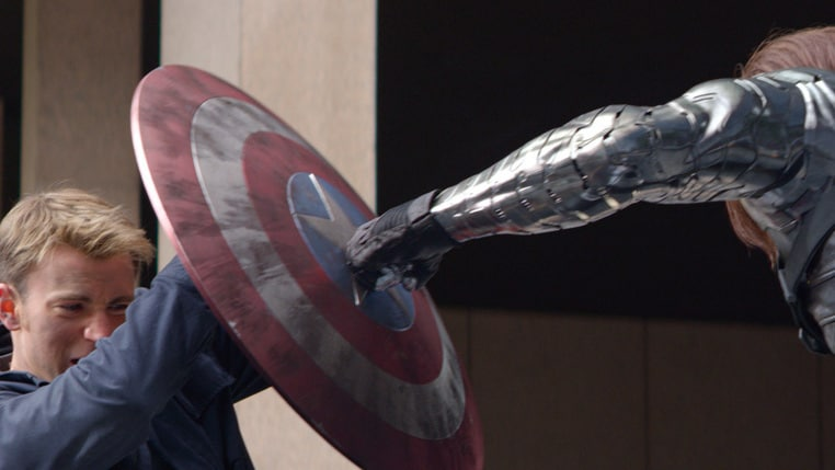 Actors Chris Evans (Steve Rogers/Captain America) and Sebastian Stan (Bucky Barnes/Winter Soldier) battle in Captain America: The Winter Soldier.