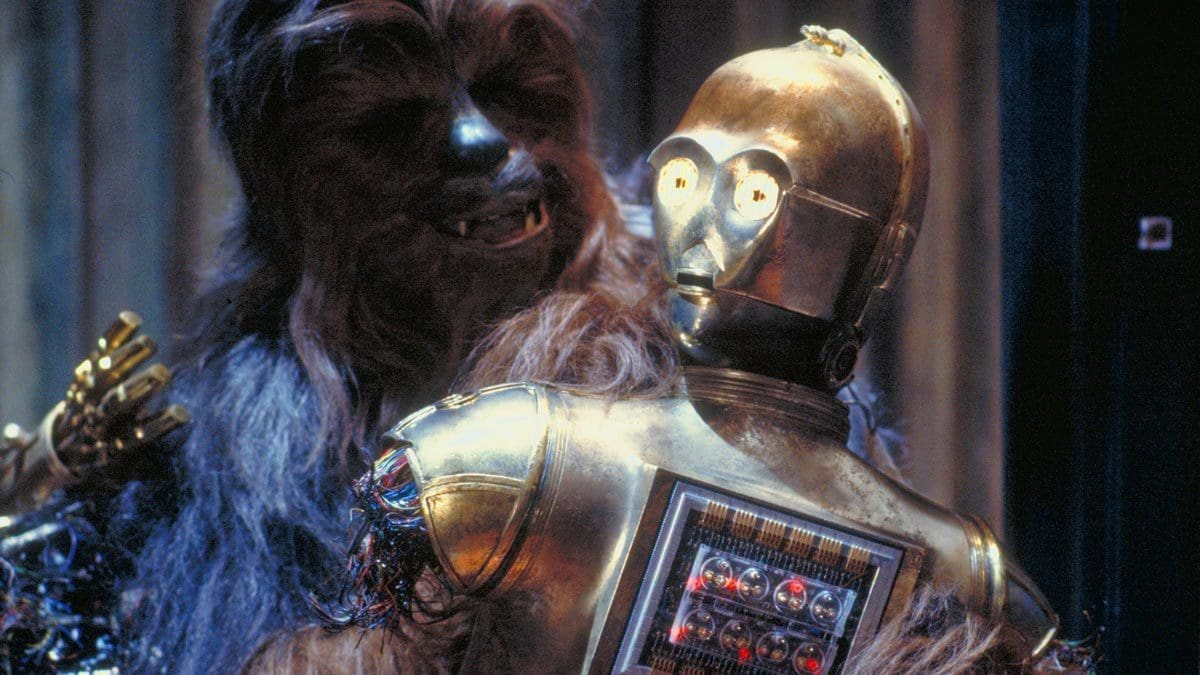 Chewbacca carrying a dismembered C-3PO in Cloud City