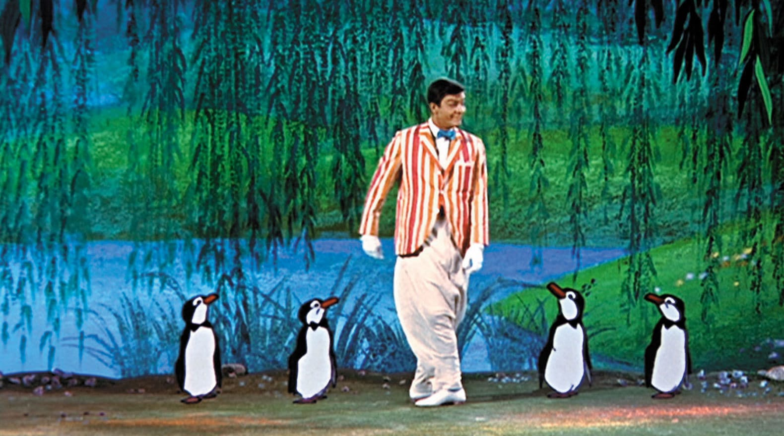 """Bert and the penguins show off their dancing skills for Mary in """"Mary Poppins"""""""
