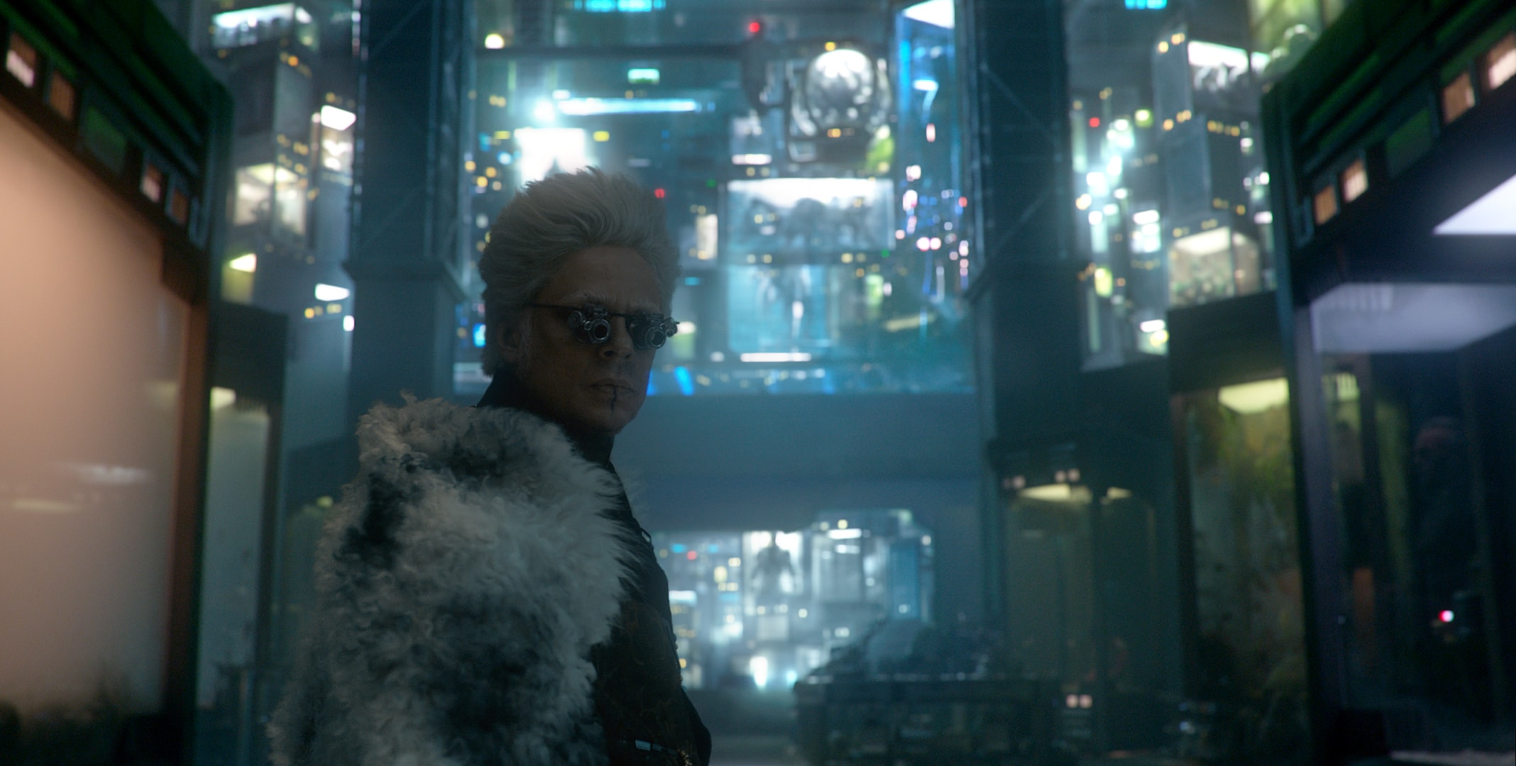 Benecio Del Toro as the Collector in front of his collection or rare aliens in the movie Guardians of the Galaxy