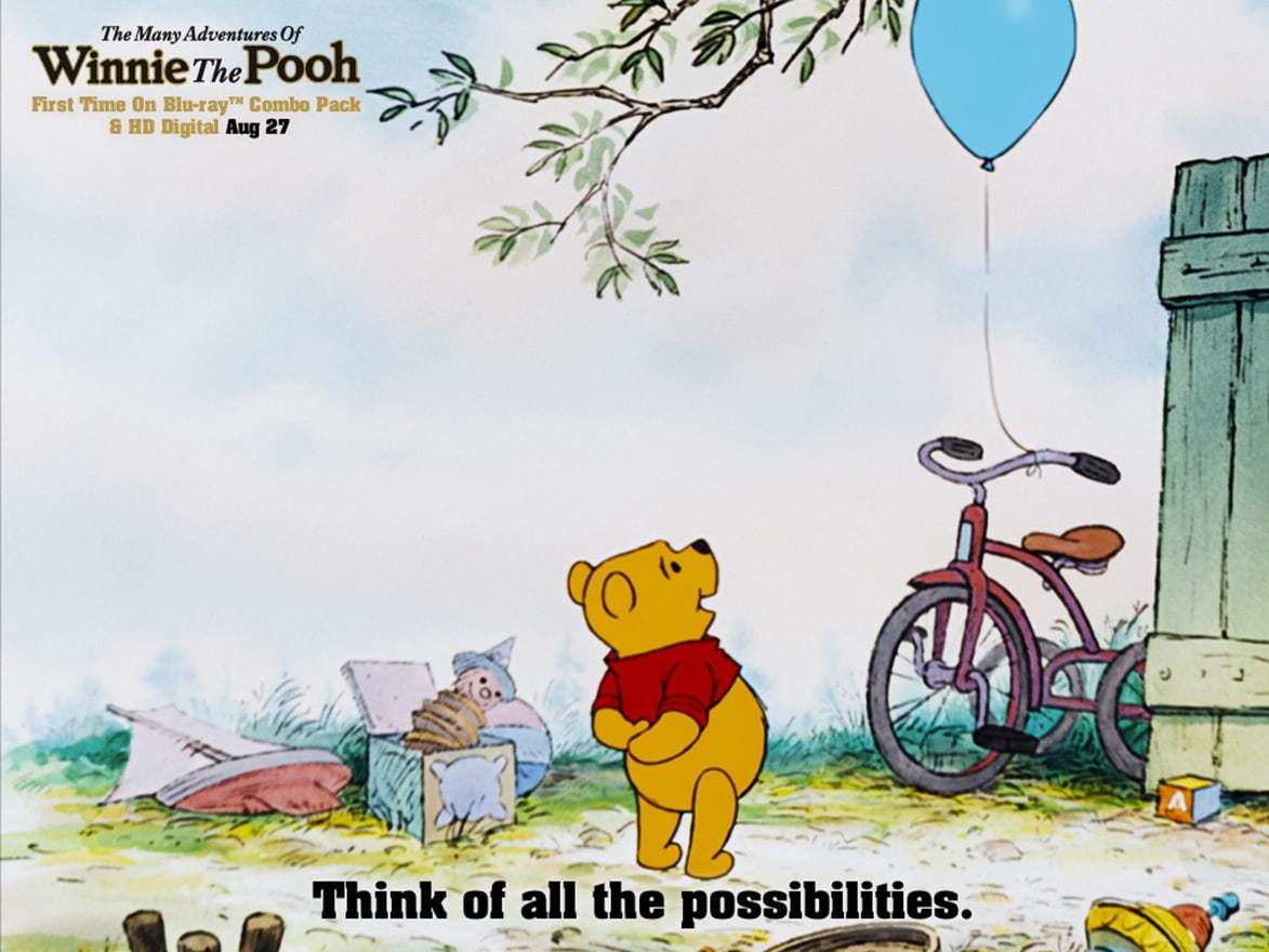 Pooh (voiced by Sterling Holloway) looking up at a balloon in the movie The Many Adventures Of Winnie The Pooh