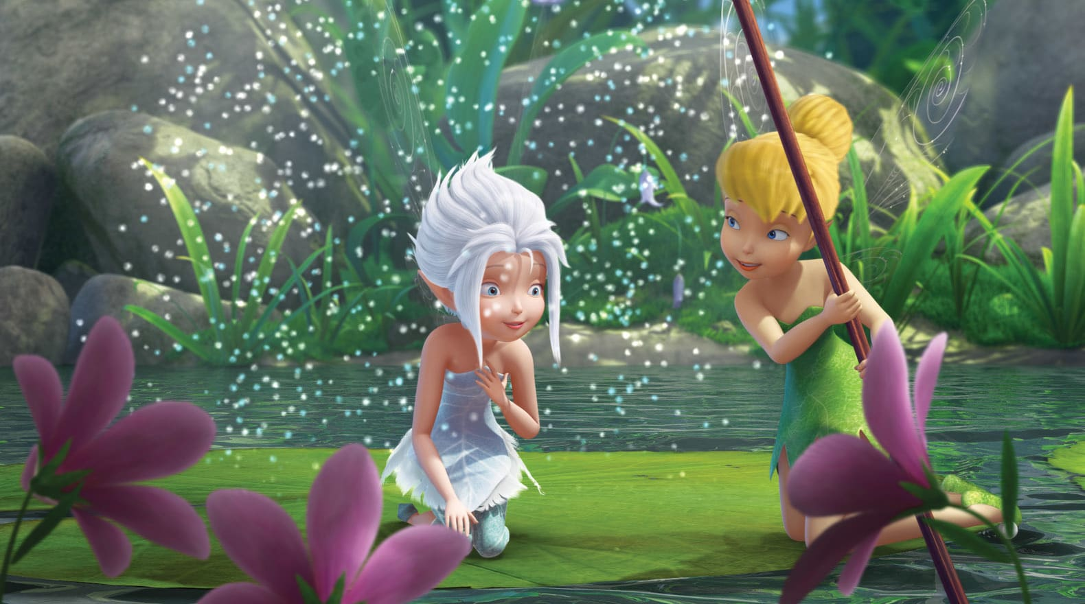 Periwinkle visits the warm side of Pixie Hollow with a little help from Tink.