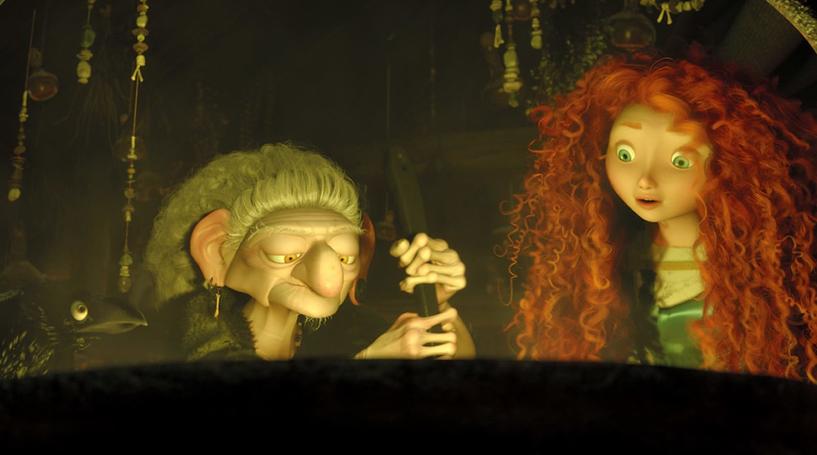 Merida, voiced by Kelly Macdonald, with The Witch, voiced by Julie Walters, who is stirring a potion in a cauldron in the movie Brave