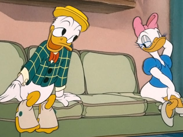 Donald tries to get Daisy's attention.