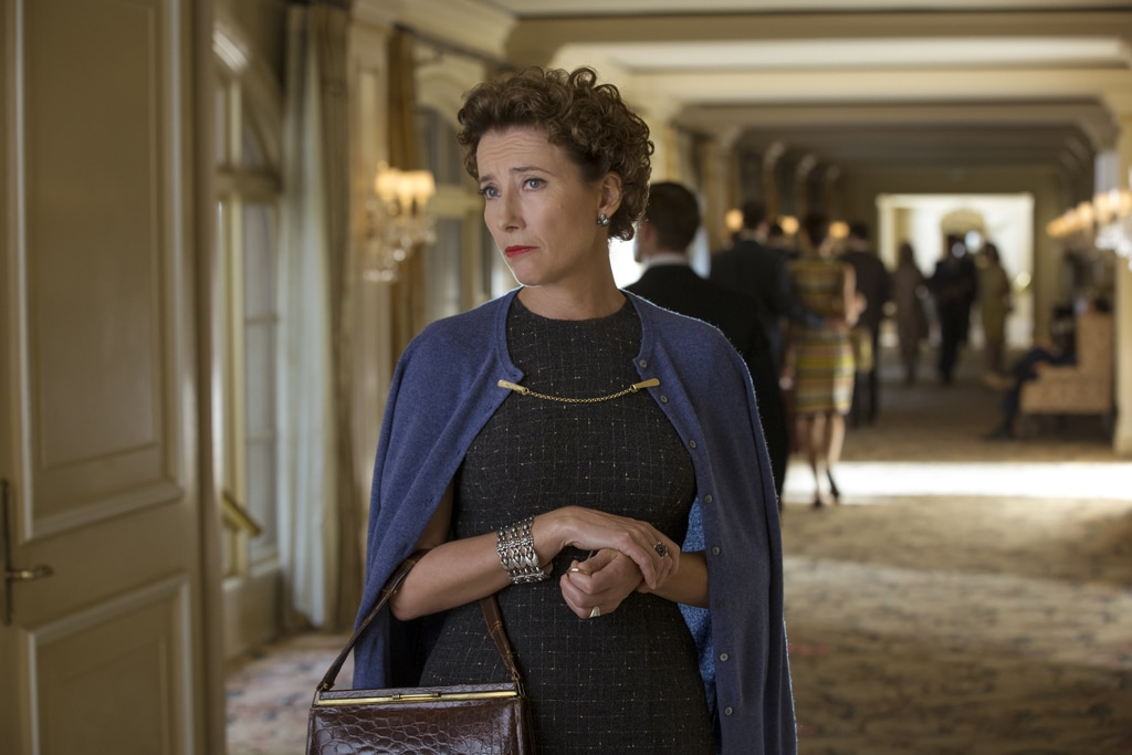 """Actor Emma Thompson as P.L. Travers standing in a hallway in the movie """"Saving Mr. Banks""""."""