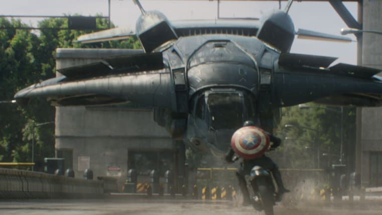 Actor Chris Evans (Steve Rogers/Captain America) on a motorcycle in Captain America: The Winter Soldier.