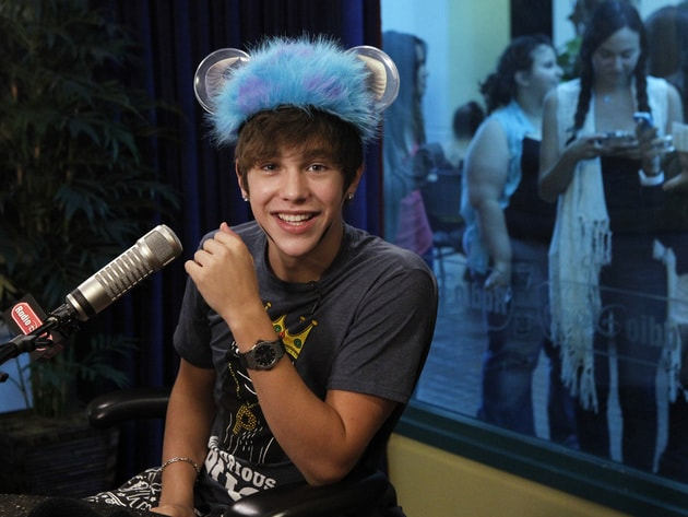 Austin tries on a new hat in the Radio Disney studio