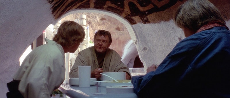 Owen Lars sharing a meal with Luke Skywalker and Beru