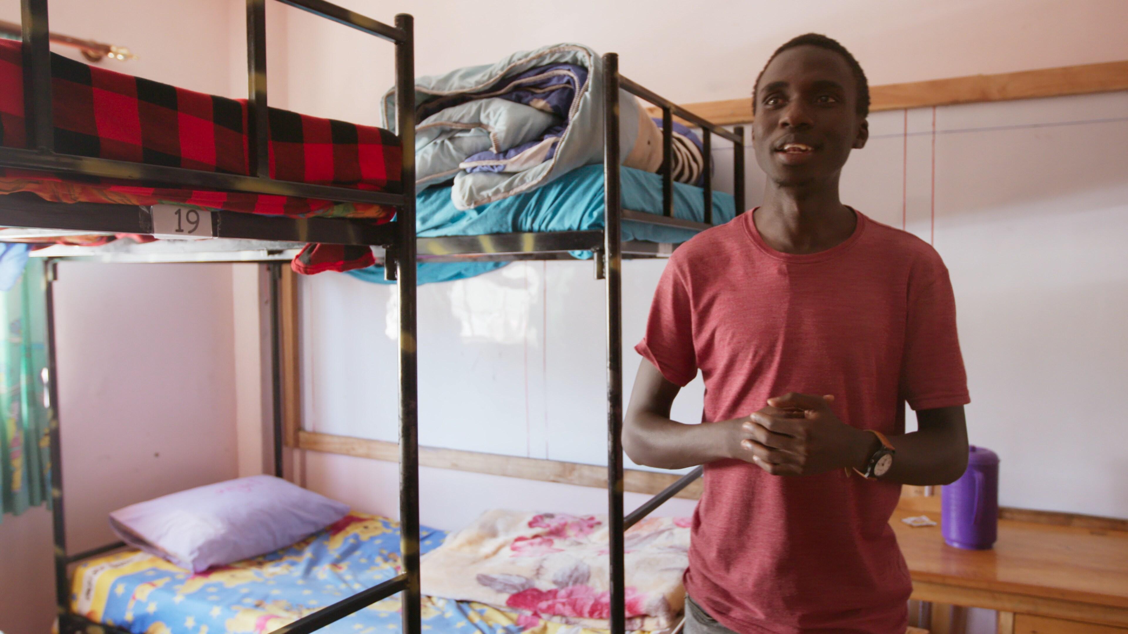 Nairobi, Kenya - Henry Onyango, founder of Roometo, gives a tour of university accommodations. (Credit: Future of Work Film Inc)