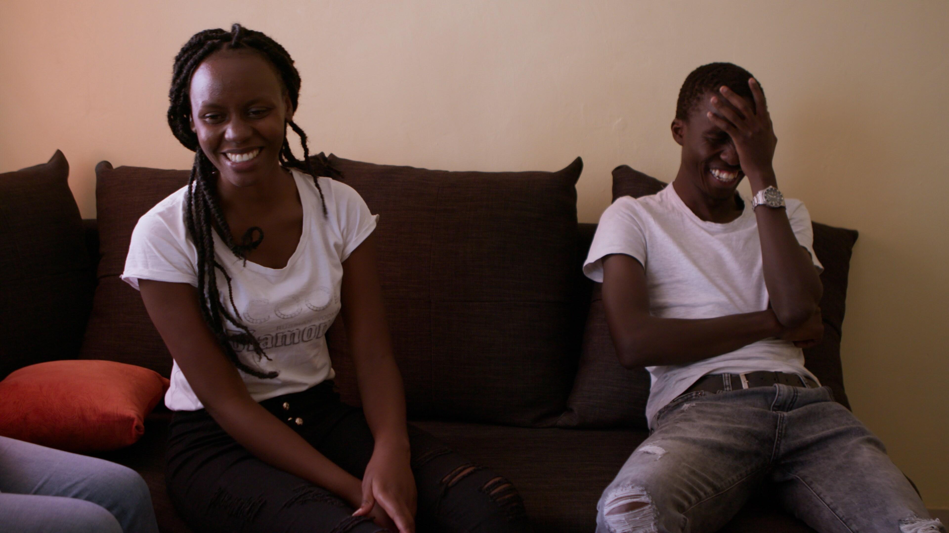 Nairobi, Kenya - Mercy Ndanu Movembi (L) tries to convince her boyfriend, Henry Onyango, to get a haircut. (Credit: Future of Work Film Inc)
