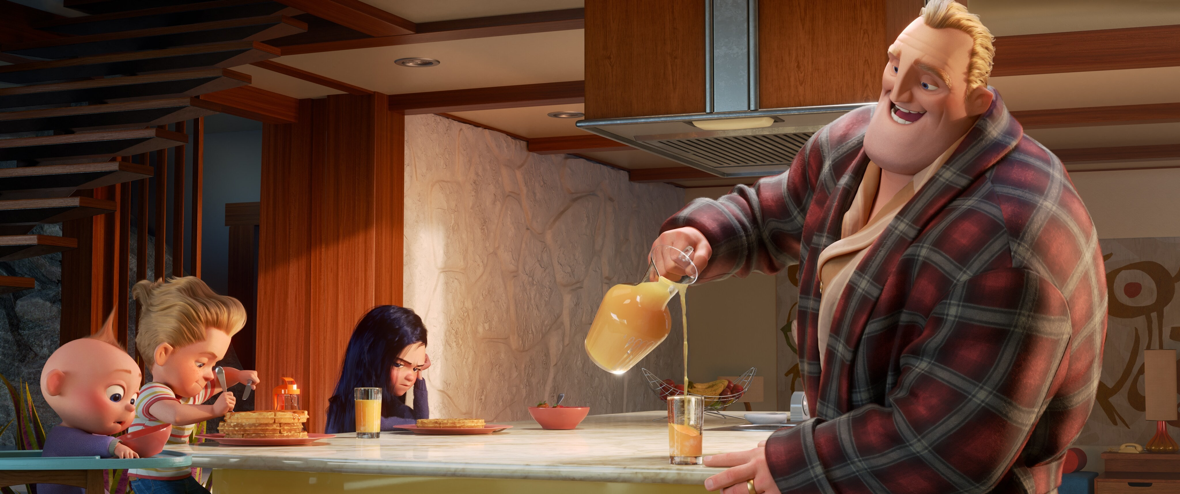 Bill Parrs (Mr. Incredible) pouring orange juice with Violet, Dash and Jack Jack at the kitchen table eating waffles