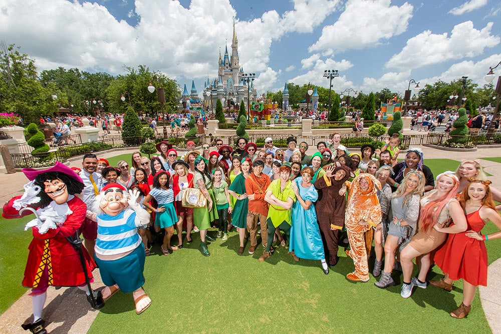Fans posing for a picture during Peter Pan's 65th Anniversary Parade