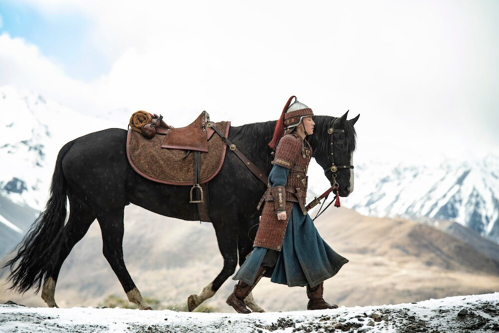 Mulan walking with horse