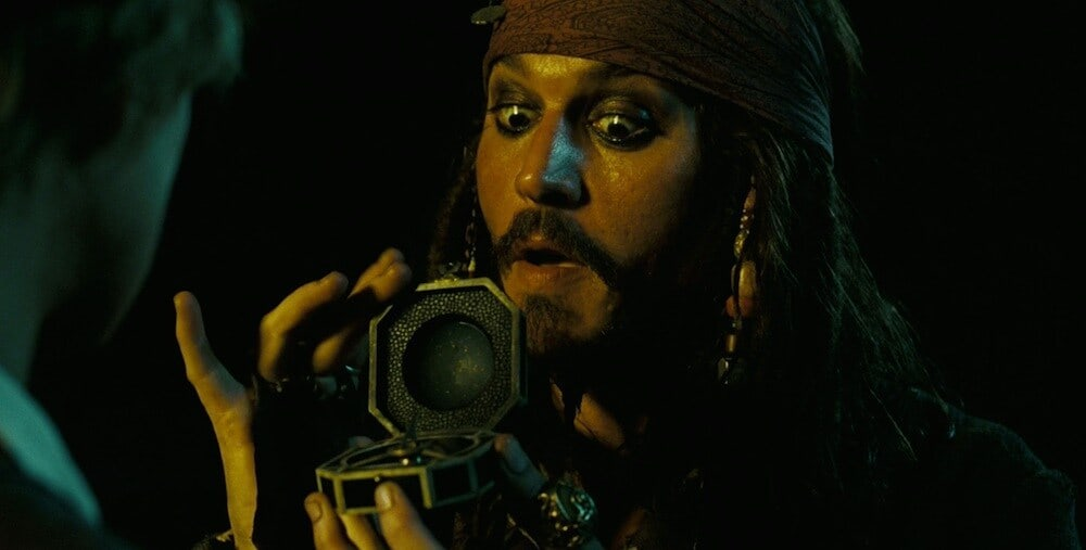 Actor Johnny Depp as Captain Jack Sparrow holding a compass