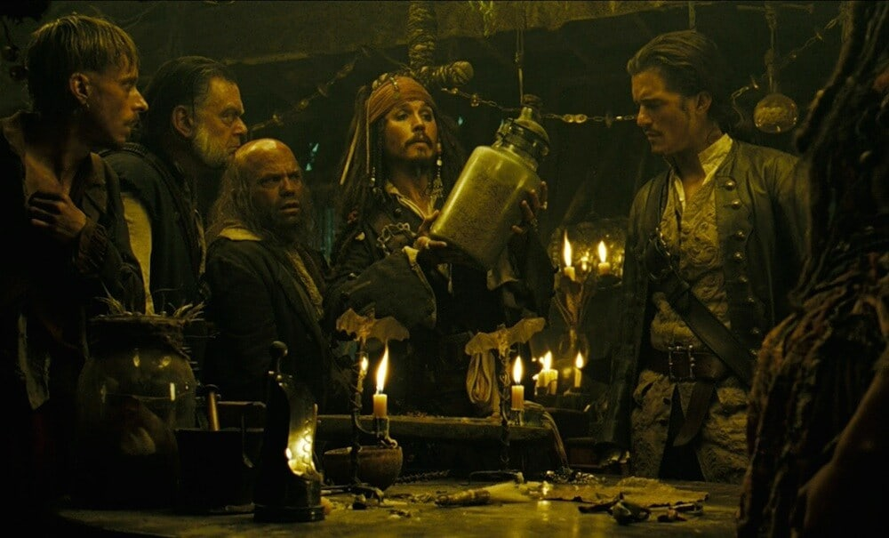 "Captain Jack Sparrow (played by Johnny Depp) and crew looking at a jar from the movie ""Pirates of the Caribbean"""