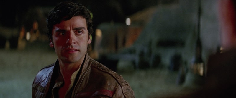 Poe Dameron talking with Lor San Tekka on Jakku