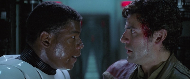 Poe Dameron being offered help to escape by FN-2187