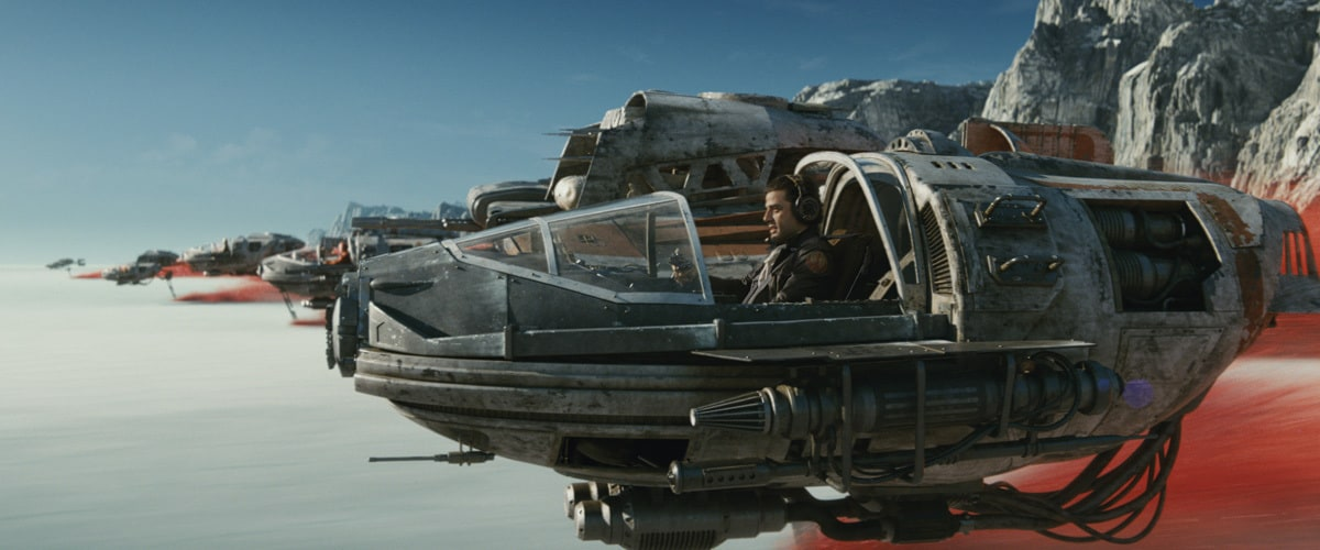 Poe Dameron piloting a Resistance ski speeder on Crait