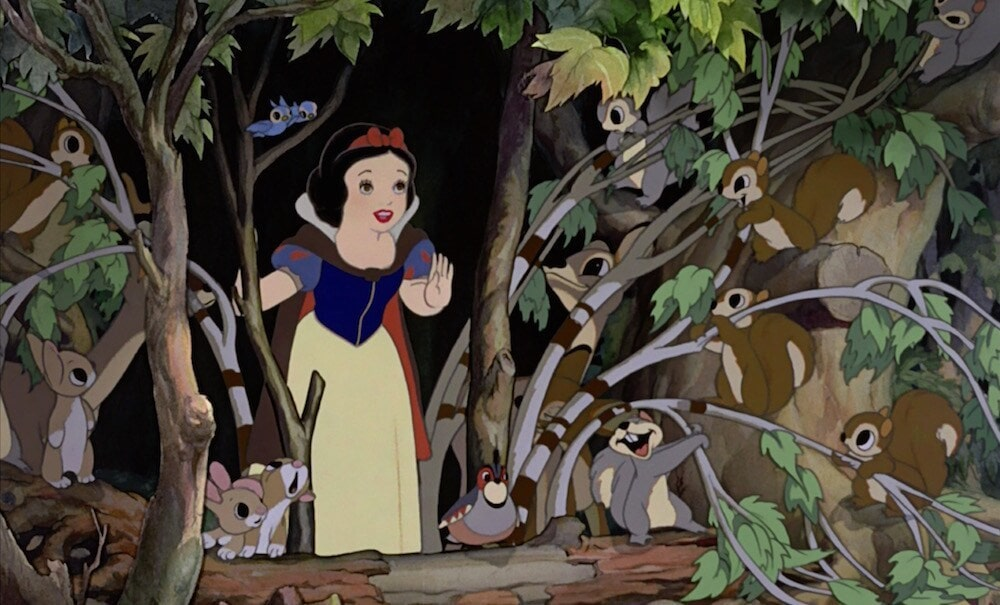 Snow White in the forest surrounded by squirrels